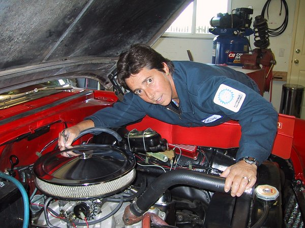 Lisa Miller Works on an Engine
